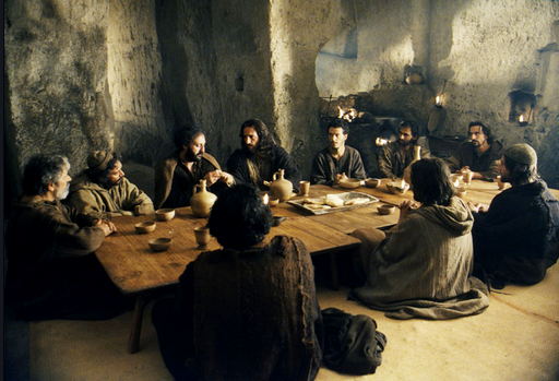 The Last Supper [Passover] with Bread and Wine which represents his body and blood.